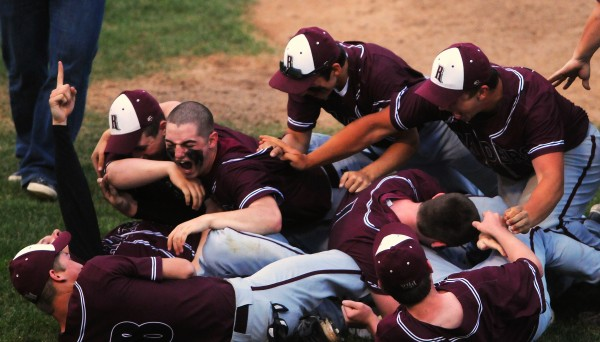 BANGOR, MAINE -- 06/17/14 -- Washington Academy celebrates after defeating George Stevens Academy during their Eastern Maine Class C baseball final at Mansfield Stadium Tuesday. Washington Academy won 3-0.