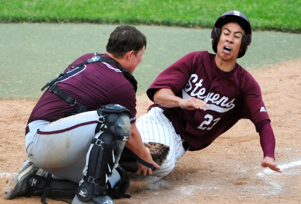 BANGOR, MAINE -- 06/17/14 -- Washington Academy's Frederick MacLean (left) tags George Stevens Academy's Kelsey Allen at home during their Eastern Maine Class C baseball final at Mansfield Stadium Tuesday. Washington Academy won 3-0.