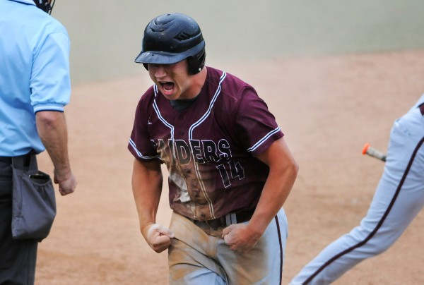 Washington Academy's Colin Pineo reacts after safely sliding home to score a run against George Stevens Academy during their Eastern Maine Class C baseball final at Mansfield Stadium Tuesday. Washington Academy won 3-0.