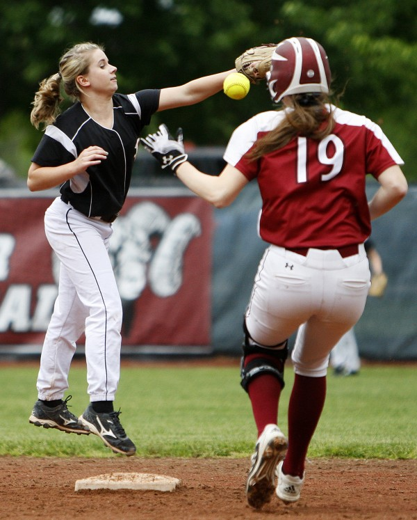 Brewer's Delaney Davis (left) misses a throw allowing Bangor's Cordelia Stewart to safely make it to second during their Class A quarterfinal softball game Thursday at Bangor.