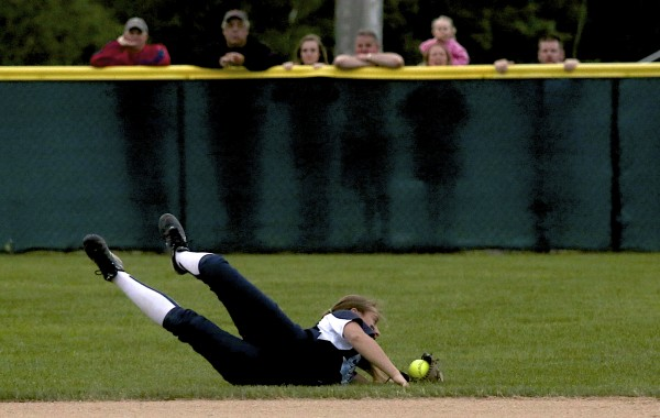 BANGOR, MAINE -- 06/17/2014 -- Kaylee Johnson of Calais High School dives for a fly ball and makes the catch to end the top of the sixth inning during their Eastern Maine Class C softball final against Bucksport Tuesday evening at Coffin Field in Brewer.