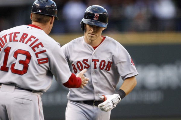 Boston's Brock Holt (26) is congratulated by Red Sox third base coach Brian Butterfield after hitting a two-run homer against the Seattle Mariners during the fourth inning at Safeco Field in Seattle Tuesday night.