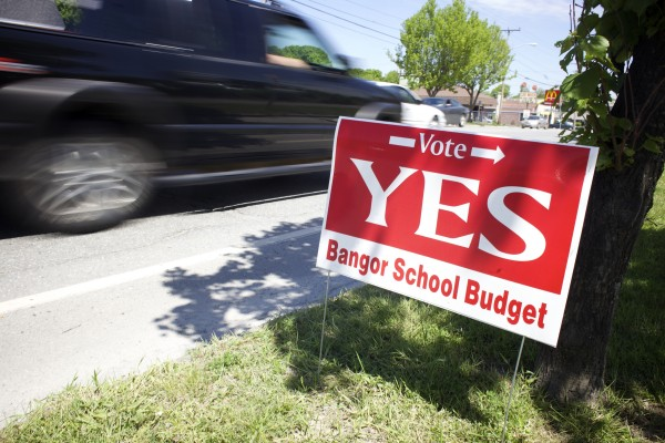 A sign paid for by the Bangor Education Association encourages residents to vote in favor of the Bangor school budget.