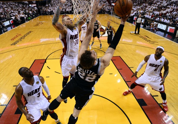 San Antonio Spurs center Tiago Splitter (22) shoots against Miami Heat forward Chris Andersen (11) during the first half of game four of the 2014 NBA Finals at American Airlines Arena in Miami Thursday night. San Antonio won 107-86.