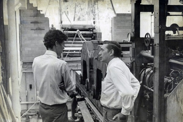 1971: Richard Warren, publisher, and Henry Downs, production manager, at the Hoe printing presses