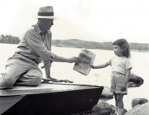 1958: A very young newsgirl makes the morning deliver