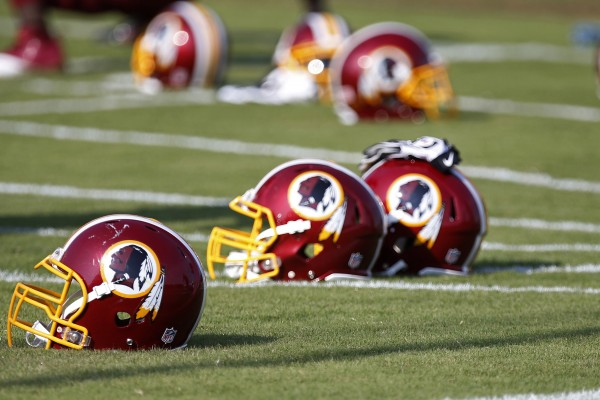 Washington Redskins helmets rest on the field during minicamp at Redskins Park on Tuesday.