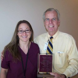 CRH CEO Michael Lally presented the 2014 Excellence Award to Ericka Marshall, RN.