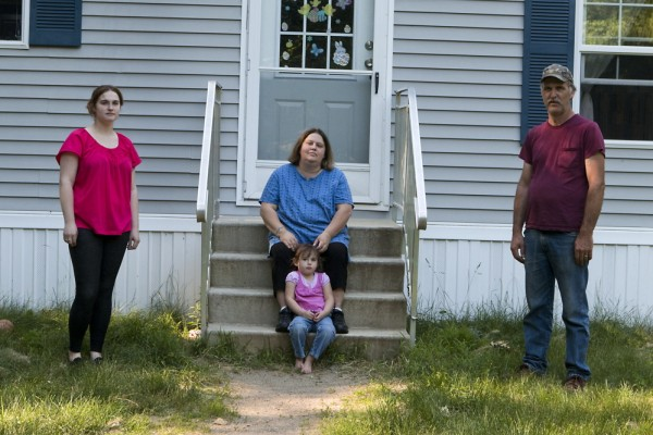 Wendy Brennan, center, outside her home with husband Peter, daughter Caitlyn and granddaughter Madelyn.
