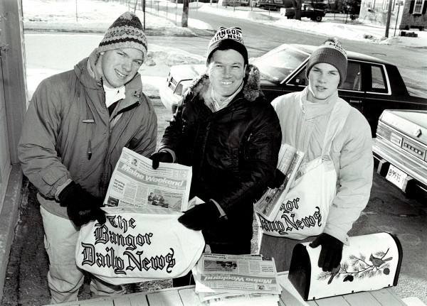 1990: Bob Haskell, Assistant City Desk Editor, and sons deliver newspapers