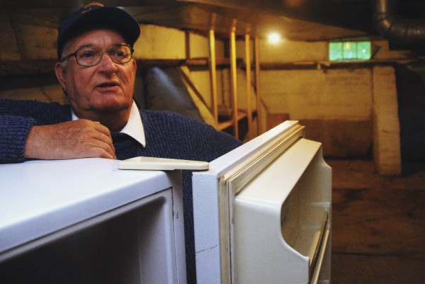 Charles Harriman talks about the burglary that occurred  at the Topsfield food pantry last month as he stands behind an empty refrigerator.