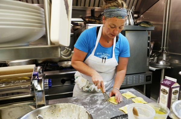Aragosta owner and head chef Devin Finigan cuts ravioli to create her signature dish, lobster ravioli, recently in Stonington.