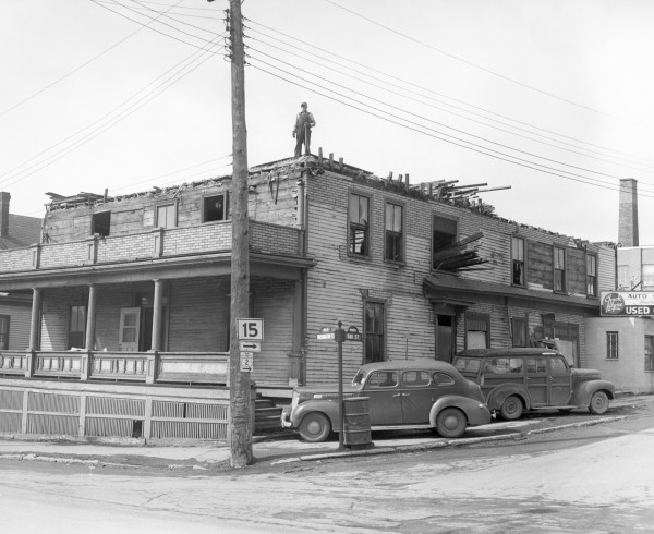One of Bangor's oldest buildings, the Atlantic Hotel at Washington and Oak streets, had seen its last days, owner Jack Rapaport said in March 1953. A workman stood at the top of the structure as outside work continued. The inside already had been demolished.