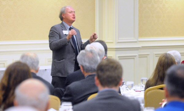 University of Maine System Chancellor James Page speaks during the Bangor Region Chamber of Commerce's Early Bird Breakfast at the Hilton Garden Inn in Bangor Thursday.