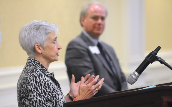 Susan Hunter, the new president of the University of Maine, (left) and University of Maine System Chancellor James Page answer questions during the Bangor Region Chamber of Commerce's Early Bird Breakfast at the Hilton Garden Inn in Bangor Thursday.