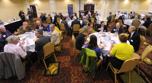 People eat during the Bangor Region Chamber of Commerce's Early Bird Breakfast at the Hilton Garden Inn in Bangor Thursday. Susan Hunter, the new president of the University of Maine, (left) and University of Maine System Chancellor James Page spoke at the event.