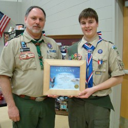 Dylan Bunker (right) of Boy Scout Troop 102 in Orland achieved Eagle Scout status recently during a ceremony in Bucksport with Scoutmaster David Burgess (left) officiating.