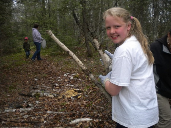 Emily Curtis helps build a trail.