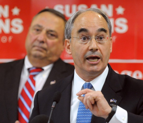 Former state treasurer Bruce Poliquin speaks at a rally for Republican politicians who are running for re-election or office at Husson University in Bangor Friday morning. Poliquin is running for the 2nd District seat in Congress. On the left is Gov. Paul LePage.