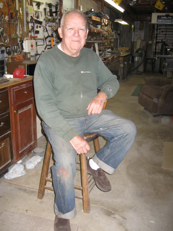 Roy Klitch of Old Town fashions fish weathervanes and other items of wood in his workshop in the cellar of his home.