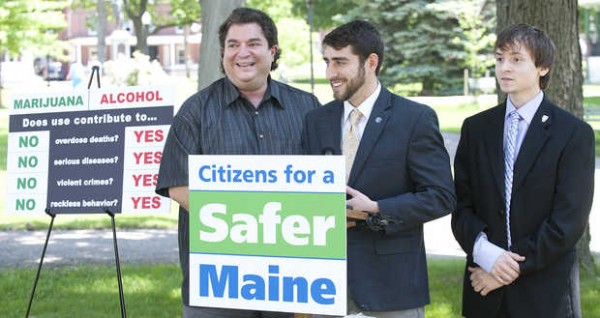 David Boyer (center), Maine political director for the Marijuana Policy Project, addresses the media and a handful of people gathered in Kennedy Park during a press conference Monday. He and his group are hoping to make legal the possession of up to 1 ounce of marijuana for recreational use and are launching an effort to collect enough voter signatures to put the issue on a citywide ballot in November. To his left is former Rep. Stavros Mendros. At right is Luke Jensen, who is running for Lewiston's House District 58 seat.
