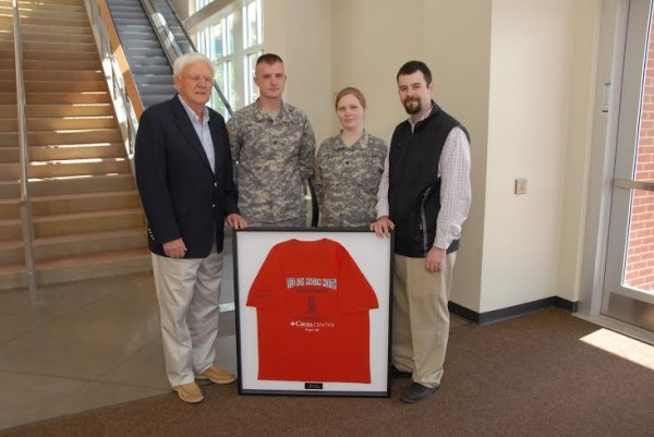 Operation Community Support, a Bangor-based nonprofit military assistance program, recently thanked the Cross Insurance Center staff for hosting a private showing of the three Boston Red Sox World Series trophies in Bangor last Jan. 26. Before the doors of the Cross Insurance Center opened to the general public that Sunday, military families spent an hour checking out the trophies and chatting with Red Sox third-base coach Brian Butterfield, who is from Orono. In a brief ceremony held in late May in the CIC lobby, Operation Community Support presented Cross Insurance Center General Manager Joe Imbriaco (right) with a framed Red Sox Nation North T-shirt that was autographed by Stephen and Tabitha King. Also participating in the ceremony were (from left) Skip Chappelle, a founding member of Operation Community Support; Sgt. Aaron Smith of Milford; and Spec. Sarah Starkey of Gray. Assigned to the 120th Regional Support Group of the Maine Army National Guard, Smith and Starkey represented Maine military families. The framed T-shirt will be displayed in the Cross Insurance Center general office.
