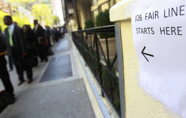 People wait in line to enter a job fair in New York in this April 18, 2012, file photo.