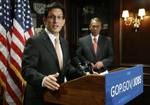 U.S. House Majority Leader Eric Cantor (left) and House Speaker John Boehner hold a news conference after a Republican Party caucus meeting on Capitol Hill in Washington in this file photo taken May 20, 2014.
