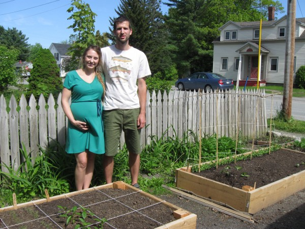 Morgan and Russ Mortland of Brewer, who are expecting their first child in August, show off the raised beds they had built along the edge of the driveway of their apartment in Brewer. With no space available for a regular garden, the Mortlands have joined the ranks of urban gardeners who find creative ways to grow vegetables in space available.
