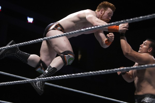Sheamus (left) leaps onto Alberto Del Rio during WWE Live in Bangor Saturday at the Cross Insurance Center.