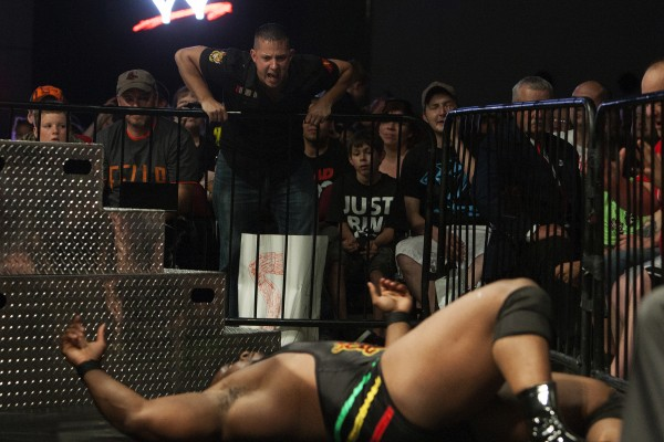 A fan yells at Big E to get up during WWE Live in Bangor Saturday at the Cross Insurance Center.