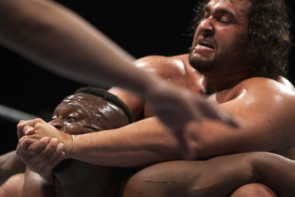 Rusev (right) chocks out Big E during WWE Live in Bangor Saturday at the Cross Insurance Center.