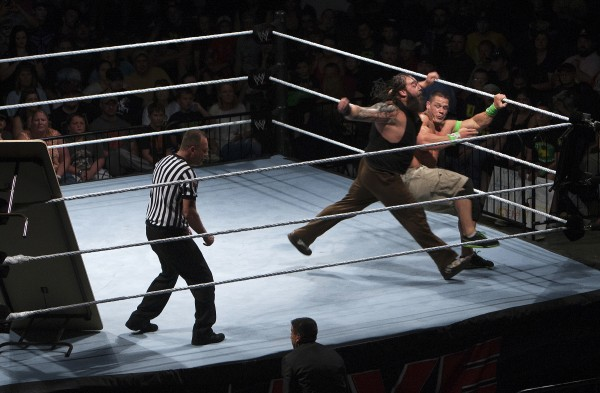 John Cena (right) is slammed into the ropes during WWE Live in Bangor Saturday at the Cross Insurance Center.