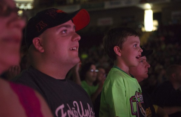 Cohen King (right), 5, watches in awe with his father John King during WWE Live in Bangor Saturday at the Cross Insurance Center.