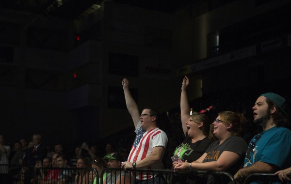 Fans cheer on their favorite wrestlers during WWE Live in Bangor Saturday at the Cross Insurance Center.