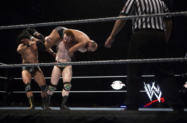 Sheamus (center) knocks Alberto Del Rio (left) in the head with Cesaro during WWE Live in Bangor Saturday at the Cross Insurance Center.