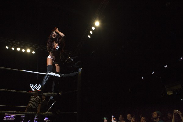 Alicia Fox makes an &quotL&quot on her forehead during WWE Live in Bangor Saturday at the Cross Insurance Center.