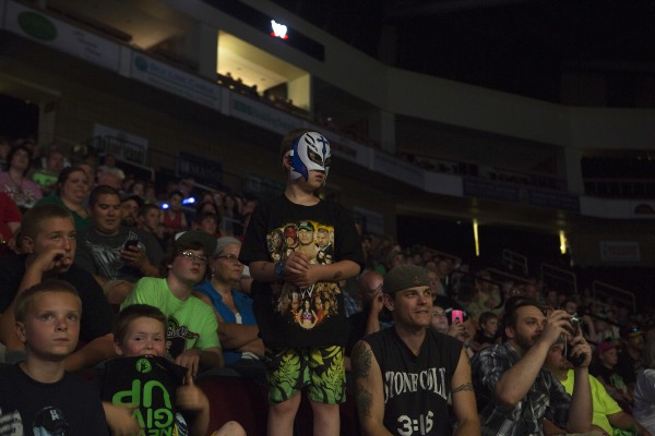 Jozef York, 8, gets a better view during WWE Live in Bangor Saturday at the Cross Insurance Center.