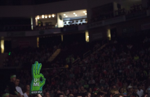 A fan raises a foam John Cena hand during WWE Live in Bangor Saturday at the Cross Insurance Center.