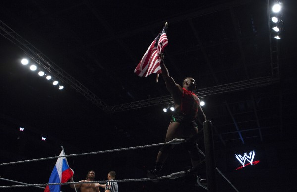 Big E waves the American flag during WWE Live in Bangor Saturday at the Cross Insurance Center.