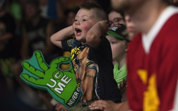 Odin Saunders, 5, yells at the wrestlers during WWE Live in Bangor Saturday at the Cross Insurance Center.