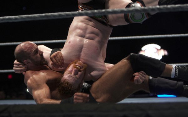 Cesaro (left) slams Sheamus during WWE Live in Bangor Saturday at the Cross Insurance Center.