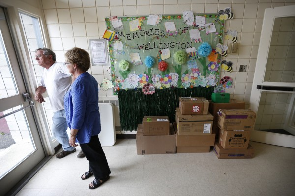 Boxes are stacked below a display on a bulletin board of student's favorite school memories at the Wellington public school in Monticello, Maine, Tuesday, June 17, 2014.