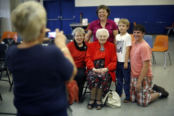 A family that has been residents of Monticello for four generations poses after an assembly at the Wellington public school in Monticello, Maine, Tuesday, June 17, 2014. Posing with 9-year-old Cody Johnston on his last day of school is his brother Dylan, 15, mother Jennifer Johnston, standing, grandmother Doris Sargent, left, and great-grandmother Louise Peterson.