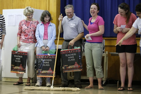 Janitor Danny Moreau, center, was given a mop as a joke at an assembly on the final day of school at the Wellington public school in Monticello, Maine, Tuesday, June 17, 2014.