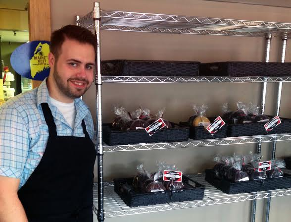 James Gallagher, owner of the Whoopie Pie Cafe in Bangor, stands beside a selection of 25 types of whoopie pies.