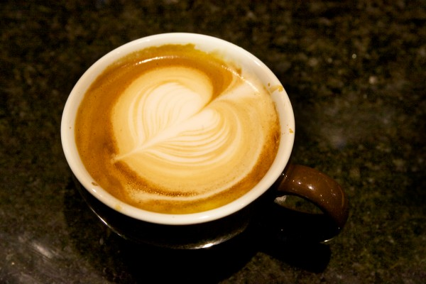 A freshly poured latte sits on the counter at Coffee By Design on Diamond Street in Portland on Friday.
