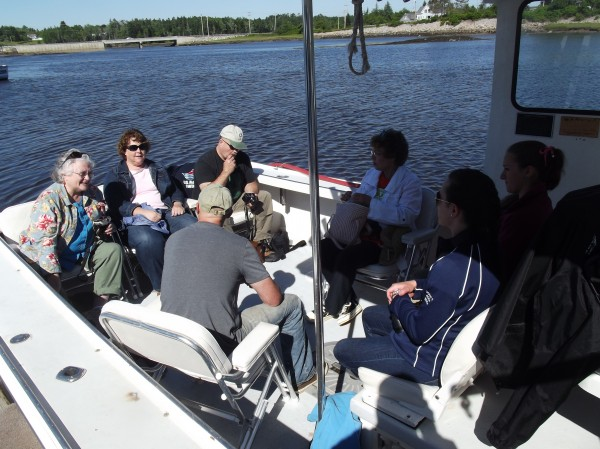 James Robertson of Harrington (back to camera), captain of the Kandi Leigh, briefs passengers aboard his boat at the Milbridge marina on what to expect before taking them on an excursion to see puffins.