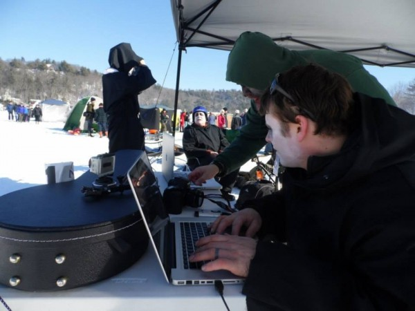 BDN Visuals Editor Brian Feulner hard at work at the 2013 Camden Snow Bowl Toboggan Races.