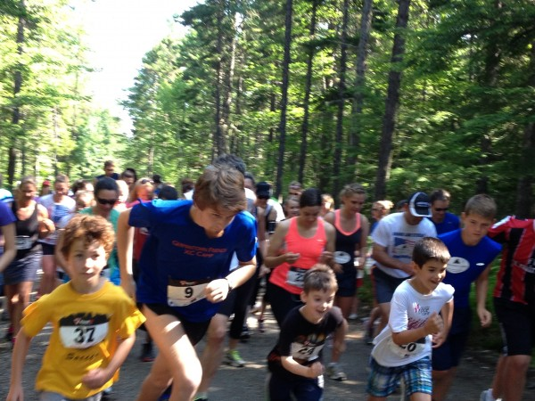 Runners take off from Big Lake, Racing to Grand Lake Stream.